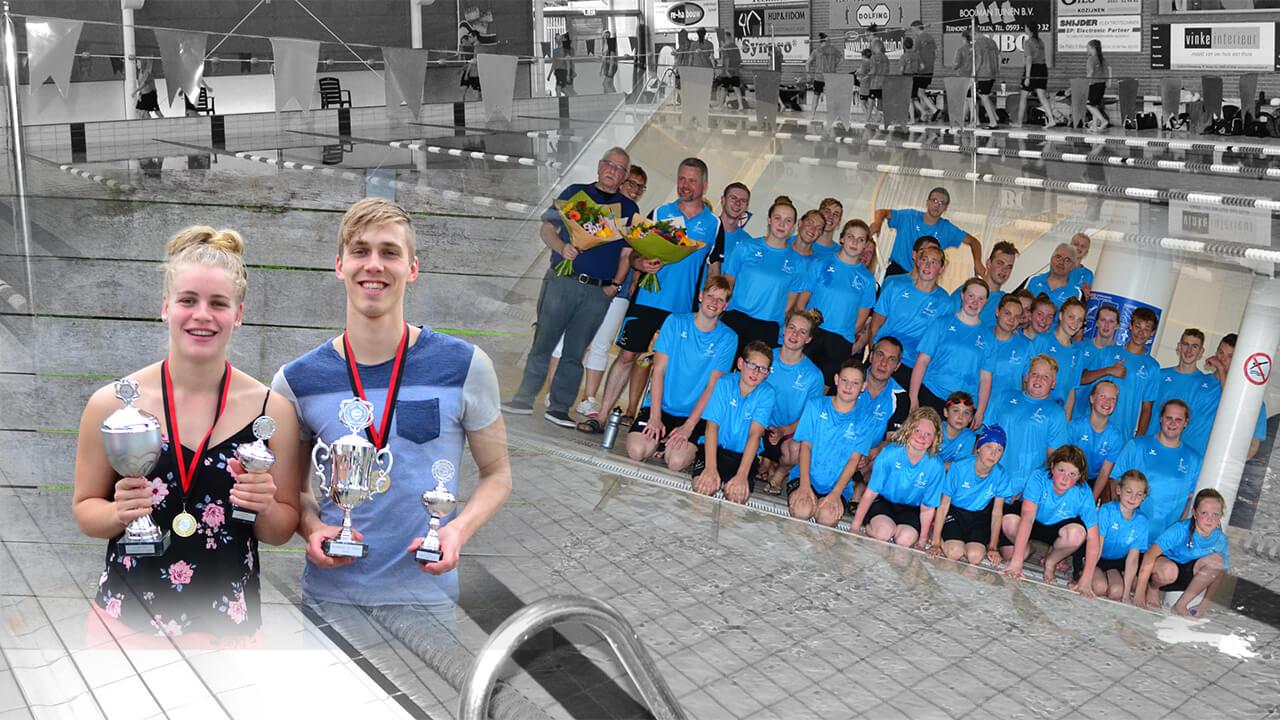 De clubkampioenen Caroline Damen en Derk Jan Speelman, en de wedstrijdzwemmers in de nieuwe kleding.